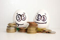 Business concept money. An egg showing Royalty Free Stock Images