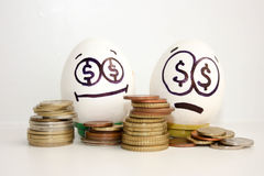 Business concept money. A happy and sad egg Stock Photo