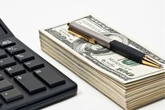 Business concept; money, pen and calculator. Royalty Free Stock Photos