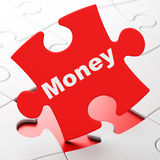 Business concept: Money on puzzle background Stock Photos