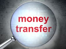 Business concept: Money Transfer with optical glass. Business concept: magnifying optical glass with words Money Transfer on digital background, 3D rendering Stock Photography