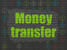 Business concept: Money Transfer on wall. Business concept: Painted green text Money Transfer on Black Brick wall background with Scheme Of Binary Code, 3d Stock Photography