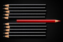 Free Business Concept Of Disruption, Leadership Or Think Different; Red Pencil In Row Of Black Pencils Pointing In Opposite Direction Stock Images - 144230794