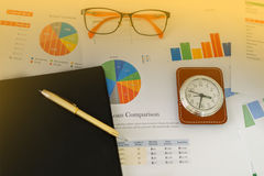 Business concept of office working and analysis graphics and clo Stock Images
