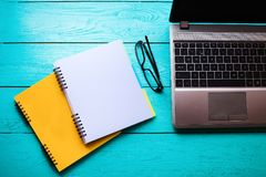 Business concept. Online education. Workplace with computer and notebooks with copy space. Top view. Mock up.  royalty free stock images