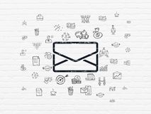 Business concept: Email on wall background. Business concept: Painted black Email icon on White Brick wall background with  Hand Drawn Business Icons Stock Photography