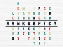Business concept: Bankruptcy in Crossword Puzzle. Business concept: Painted black word Bankruptcy in solving Crossword Puzzle Stock Photo