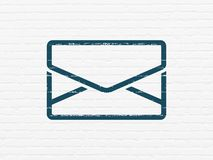 Business concept: Email on wall background. Business concept: Painted blue Email icon on White Brick wall background Royalty Free Stock Photography