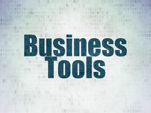 Business concept: business tools on digital data paper background. Business concept: painted blue word business tools on digital data paper background Royalty Free Stock Photos
