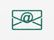 Business concept: Email on wall background. Business concept: Painted green Email icon on White Brick wall background Royalty Free Stock Image