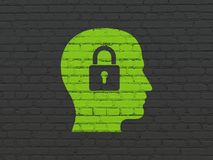 Business concept: Head With Padlock on wall background. Business concept: Painted green Head With Padlock icon on Black Brick wall background Royalty Free Stock Images