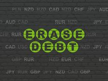 Business concept: Erase Debt on wall background. Business concept: Painted green text Erase Debt on Black Brick wall background with Currency Stock Images
