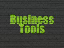Business concept: Business Tools on wall background. Business concept: Painted green text Business Tools on Black Brick wall background Royalty Free Stock Photo