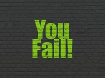 Business concept: You Fail! on wall background. Business concept: Painted green text You Fail! on Black Brick wall background Royalty Free Stock Images