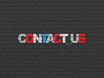 Business concept: Contact us on wall background. Business concept: Painted multicolor text Contact us on Black Brick wall background Stock Photography
