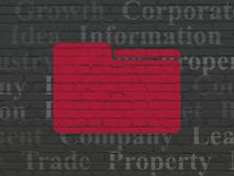 Business concept: Folder on wall background. Business concept: Painted red Folder icon on Black Brick wall background with  Tag Cloud Royalty Free Stock Photos