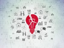 Business concept: Light Bulb on Digital Data Paper background. Business concept: Painted red Light Bulb icon on Digital Data Paper background with  Hand Drawn Royalty Free Stock Image