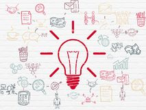 Business concept: Light Bulb on wall background. Business concept: Painted red Light Bulb icon on White Brick wall background with Scheme Of Hand Drawn Business Stock Photography