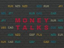 Business concept: Money Talks on wall background. Business concept: Painted red text Money Talks on Black Brick wall background with Currency Royalty Free Stock Photo
