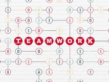 Business concept: Teamwork on wall background. Business concept: Painted red text Teamwork on White Brick wall background with Binary Code Royalty Free Stock Image