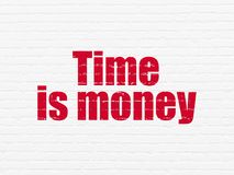 Business concept: Time Is money on wall background. Business concept: Painted red text Time Is money on White Brick wall background Stock Photos
