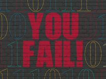 Business concept: You Fail! on wall background. Business concept: Painted red text You Fail! on Black Brick wall background with Binary Code Royalty Free Stock Photo