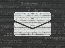 Business concept: Email on wall background. Business concept: Painted white Email icon on Black Brick wall background with  Tag Cloud Stock Photo
