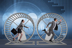 The business concept with pair running on hamster wheel Royalty Free Stock Photography