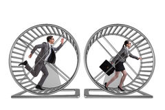 The business concept with pair running on hamster wheel Stock Photography