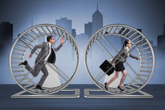 The business concept with pair running on hamster wheel Royalty Free Stock Images