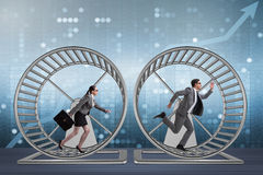 The business concept with pair running on hamster wheel Royalty Free Stock Image