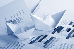 Business concept, paper boat and documents Stock Photo