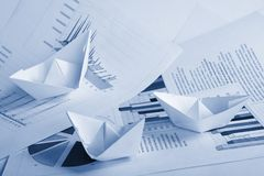 Business concept, paper boat and documents Royalty Free Stock Photos