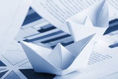 Business concept, paper boat and documents Royalty Free Stock Photography