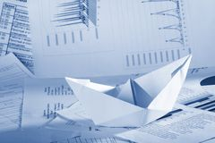Business concept, paper boat and documents Royalty Free Stock Image