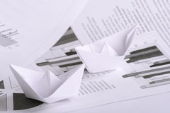 Business concept, paper boat and documents Stock Images