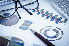 Business concept, Pen,eyeglasses and calculator Royalty Free Stock Images