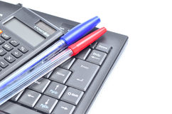 Business concept with pen, keyboard and calculator Royalty Free Stock Photography