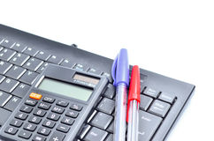 Business concept with pen, keyboard and calculator Stock Image