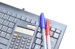 Business concept with pen, keyboard and calculator Stock Photos