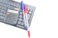 Business concept with pen, keyboard and calculator Royalty Free Stock Photos
