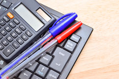 Business concept with pen, keyboard and calculator Stock Images