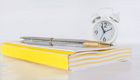 pen,note and clock on wood table royalty free stock image