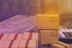 Business concept: Pile of light brown small cardboard boxes. Con stock images