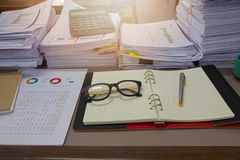 Business Concept, Pile of unfinished documents on office desk Royalty Free Stock Image