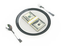 Business concept - Plate, cutlery and dollar banknotes Royalty Free Stock Photos
