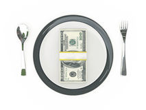 Business concept - Plate, cutlery and dollar banknotes Royalty Free Stock Image