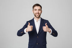 Business Concept - Portrait Handsome Business man giving double thump up. Isolated on White Background. Stock Images
