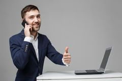 Business Concept - Portrait Handsome Business man showing thumb up and smiling confident face in front of his laptop stock image