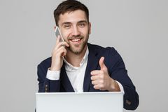 Business Concept - Portrait Handsome Business man showing thump up and smiling confident face in front of his laptop. White Background.Copy Space stock images